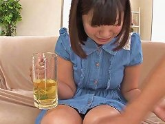 Breathtaking Japanese Cowgirl Pissing In Glass Before Drinking Her Urine