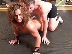Muscled Woman Wrestles Her Male Friend